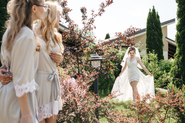 bride-her-friends-are-walking-sunny-garden_8353-9599